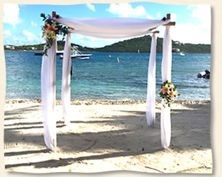 Flowers On Beach Arch Wedding